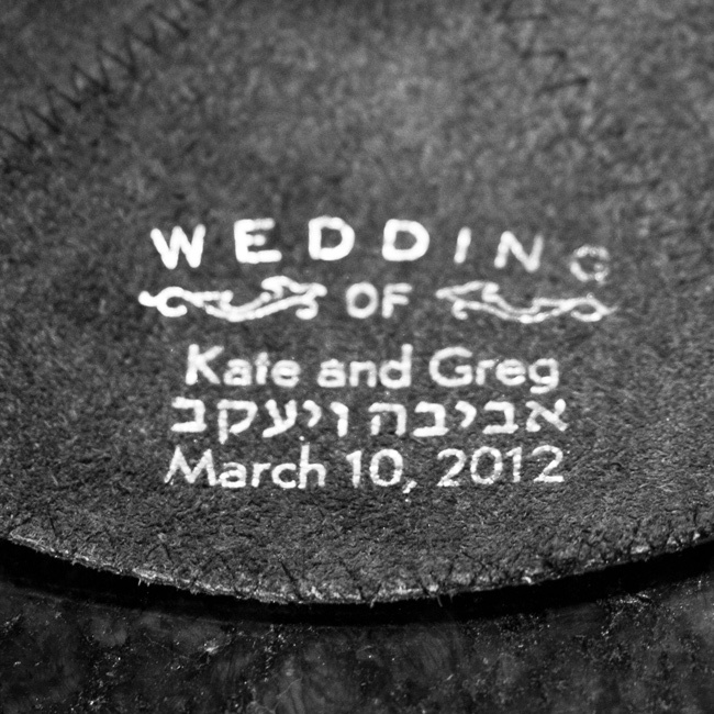Kate and Greg's Hebrew names and wedding date were printed inside the gray suede yarmulkes.