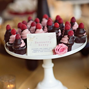 The couple wanted to please all their guests, so in lieu of traditional cake they served a variety of cupcakes in flavors like chocolate peanut butter, red velvet and dark chocolate raspberry.