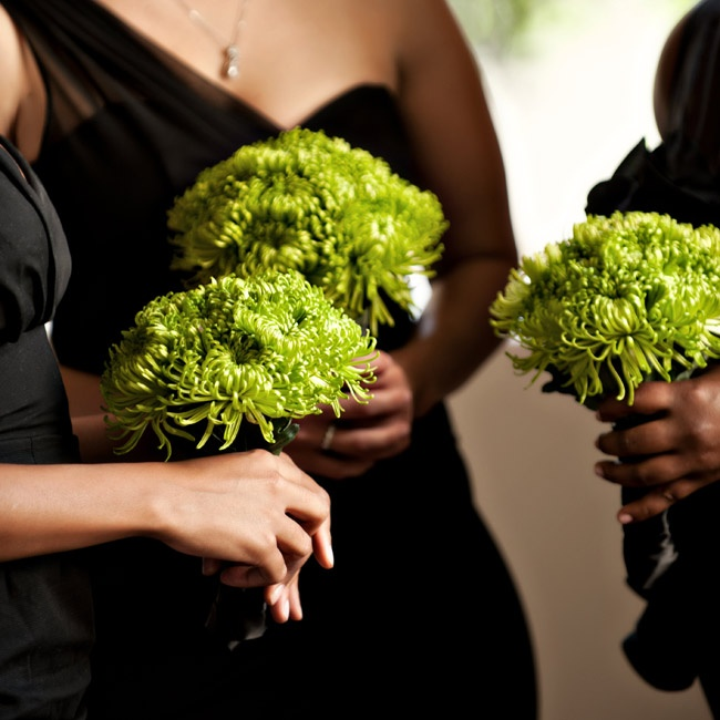 Bouquets of lime-green mums provided a burst of color against the black bridesmaid dresses.