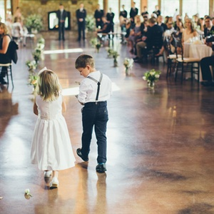 The flower girl wore a white handmade dress; the ring bearer followed suit in a crisp white shirt and retro suspenders.