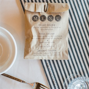 The menu was printed in a typewriter font on Kraft paper bags, which were filled with Wet-Naps and mints.