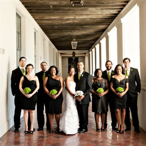 The bridal party picked out different styles of black dresses and suits. Lime green ties and bridesmaid bouquets brought the look together.