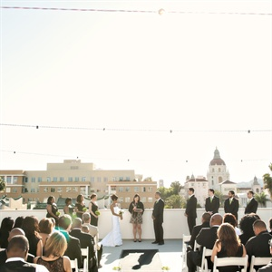 The ceremony was held outside in the evening with a beautiful cityscape view.