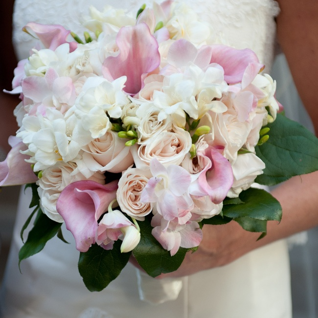 Allison's bridal bouquet was a fragrant arrangement of ivory roses, freesia, pale pink calla lilies and delicate orchids.