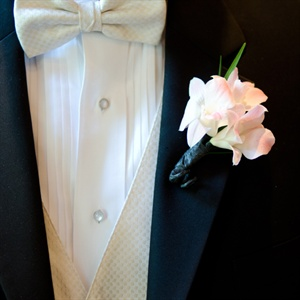 The groom's pale-pink orchid boutonniere perfectly complemented the bridal bouquet.