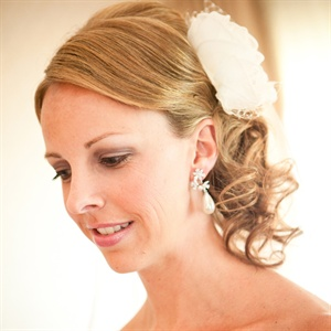 The summer weather inspired Allison to add an ivory flower accessory in her curly, side-do.