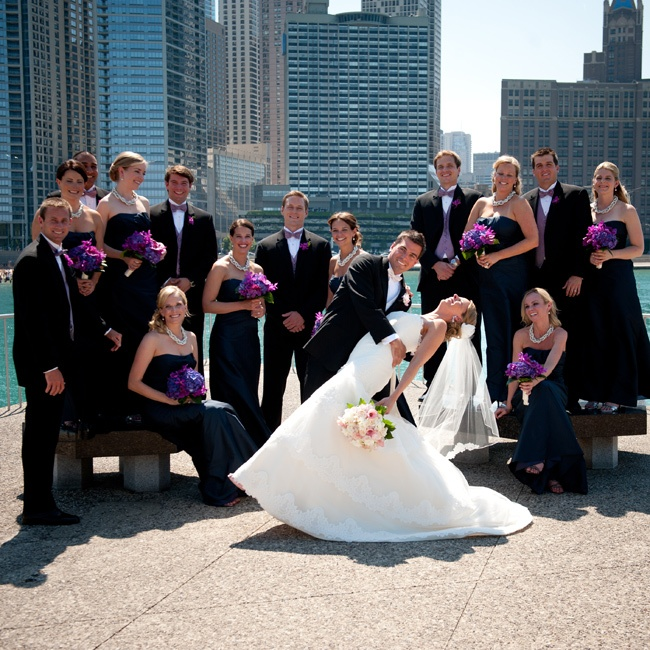 The purple and fuchsia bridesmaid bouquets brilliantly stood out against the backdrop of their navy, floor-length dresses.