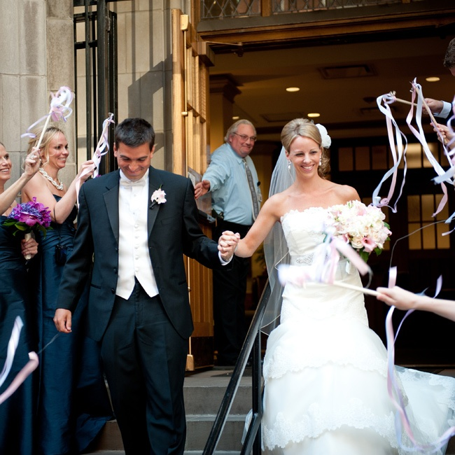 The guests waved handmade wands of ribbon and bells as Allison and Todd made their getaway.