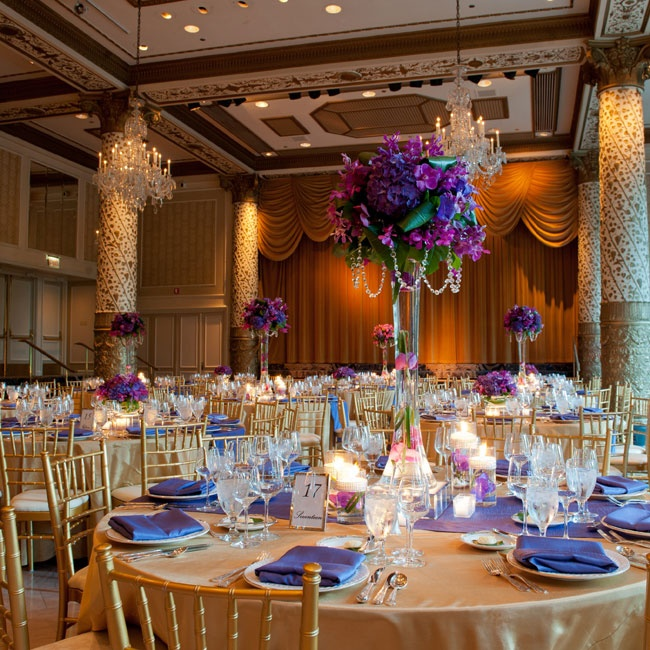 Tall centerpieces of vibrant purple and fuchsia flowers caught the guests' eyes upon entering the ballroom.