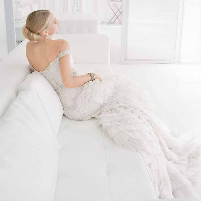 Mix sparkles with ruffles and an off-the-shoulder neckline, and they suddenly smolder. Gown, $8,570, BadgleyMischka.com; earrings,