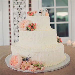 White Cake with Coral Accents
