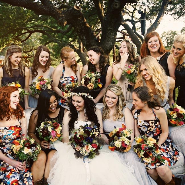 Mismatched bridesmaid dresses and colorful bouquets created a whimsical bohemian feel.