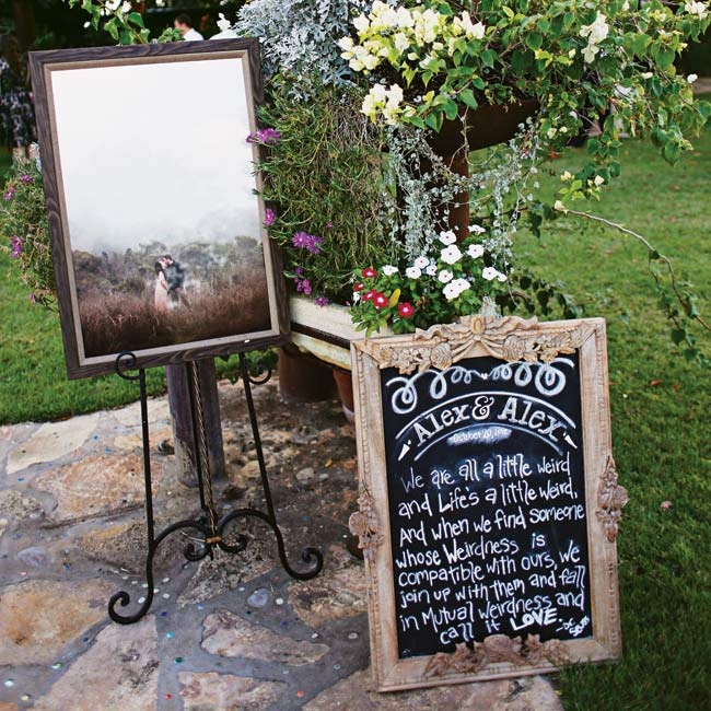 An engagement photo, along with a chalkboard displaying the couple's favorite Dr. Seuss quote, greeted guests as they arrived at the reception.