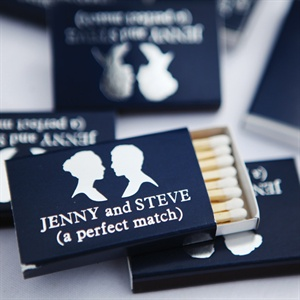 The custom matches, which were a hit at the reception, incorporated the navy blue from the bridesmaid dresses and the stationery.