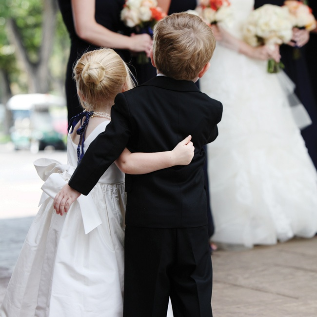 """Our flower girl and ring bearer really stole the show!"" Jenny says of the adorable duo, who spent the ceremony exploring the venue."