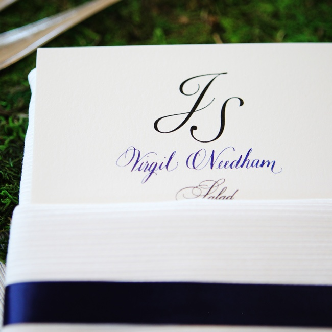 Jenny and Steve carried over the navy of the bridesmaid dresses to the ink for the menu, the names on the place cards and the ribbon on the napkins at the table.
