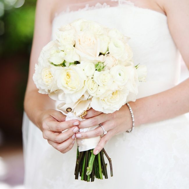 The bridal bouquet featured roses, garden roses and ranunculus.