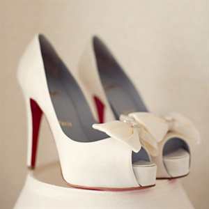 White Louboutin Heels
