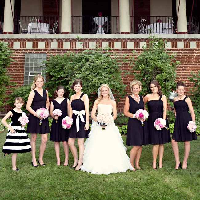 All of the bridesmaids wore short black dresses.