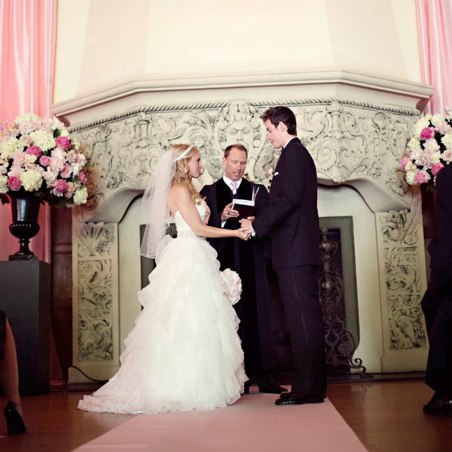 A large fireplace and soft-pink draping defined Katherine and Graham's ceremony space and put a new twist on the idea of an
