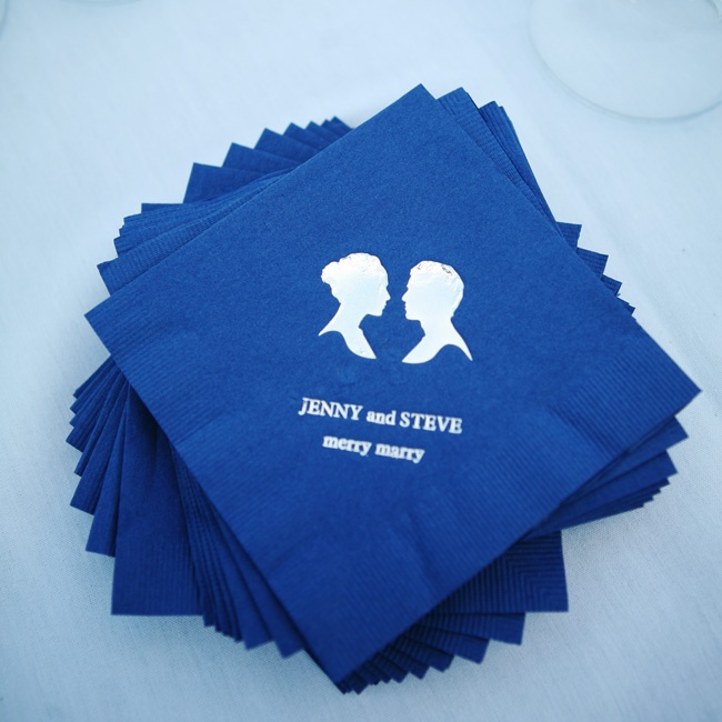 "Personalized cocktail napkins in navy with adorable silhouettes and the caption ""Merry Marry""."