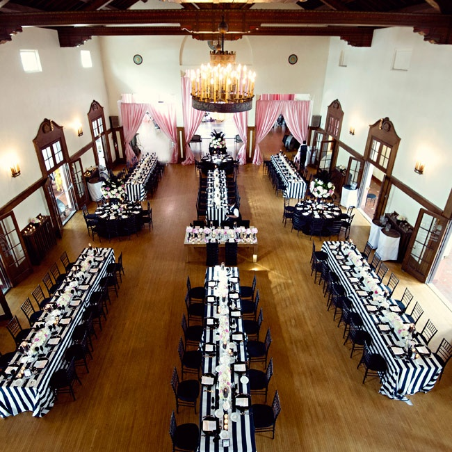 Rather than going with just round tables, the couple wanted a more formal feel and chose a mixture of long, farm-style tables and round tables. The balance of the two gave the room a dynamic and sophisticated vibe.