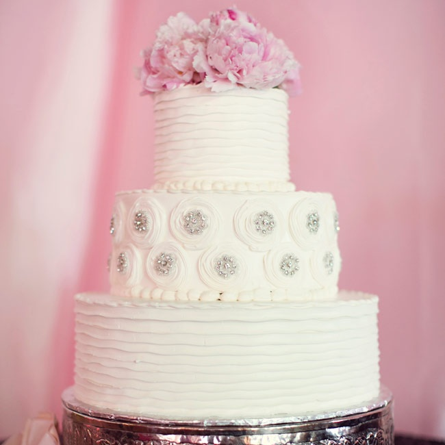 The three-tiered buttercream cake was decked out with crystal buttons and frosting ruffles to mimic the details on Katherine's dress.