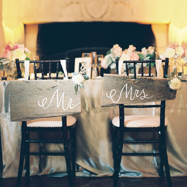 """Rachel and her mom made the rustic """"Mr."""" and """"Mrs."""" signs from reclaimed wood they found together."""