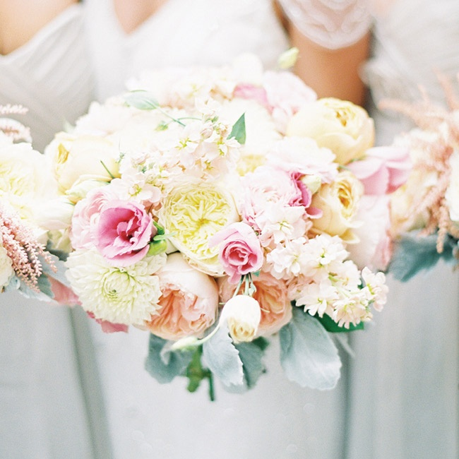 Rachel collected photos of flowers for months before meeting with her florists. Ivory dahlias, blush-pink ranunculus, blush-pink lisianthus, antique-peach stock and three different varieties of garden roses eventually came together in a gorgeous, multitextured bouquet.
