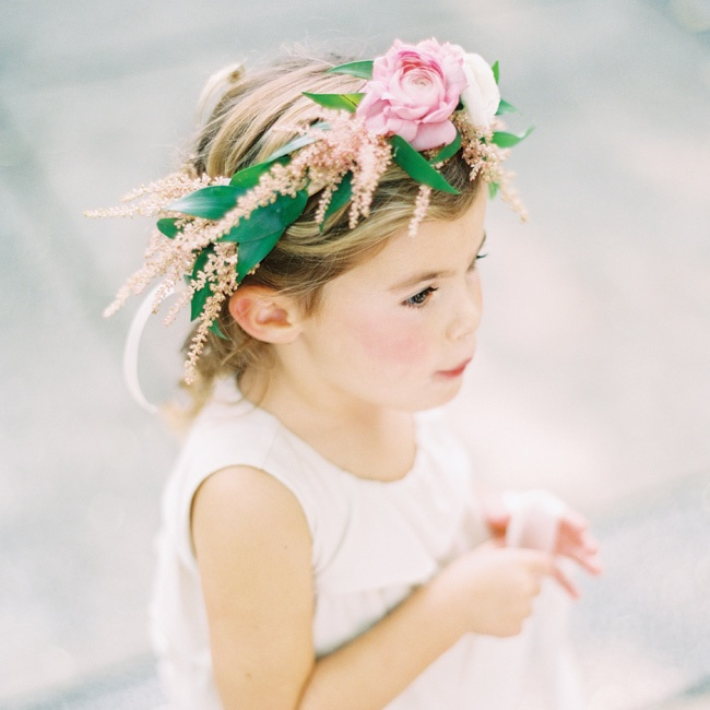 The three flower girls wore floral crowns that matched the blush rose petals they threw walking down the aisle.