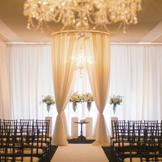 Two days before the ceremony, Hurricane Isaac dashed plans for an outdoor wedding. The chandelier, chiavari chairs and draped walls and huppah achieved the same warm ambiance inside the country club.
