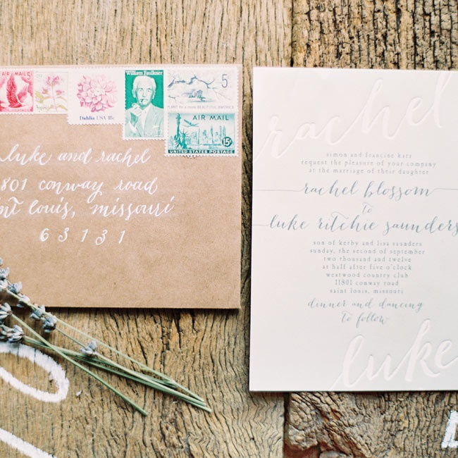 The light-green invitations were debossed with ivory lettering. Beautiful calligraphy in white ink dressed up informal kraft-paper envelopes, and vintage stamps added a pop of color.