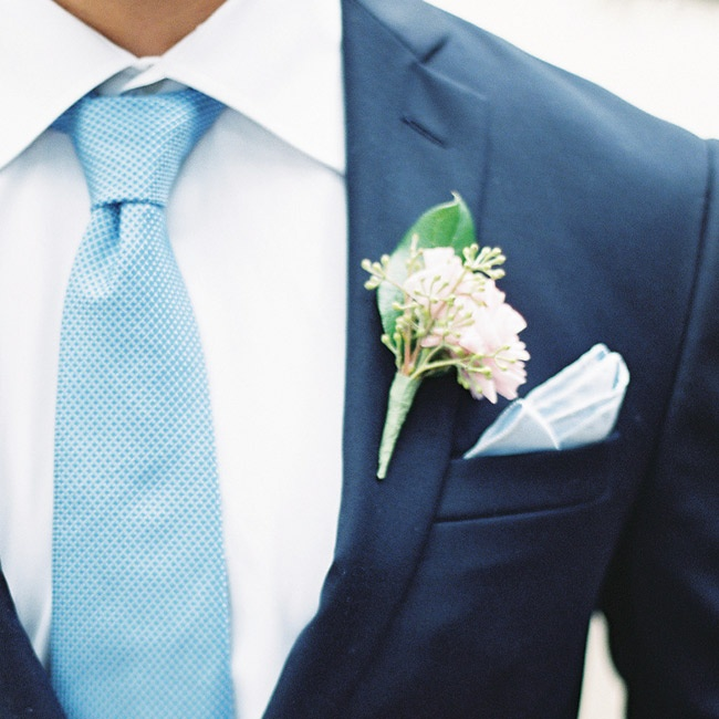The men wore boutonnieres made of mini ranunculuses.