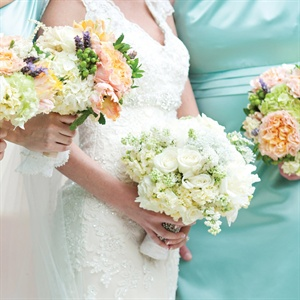 Kady's garden bouquet of freesia, peonies, roses and hydrangeas was embellished with a rhinestone brooch her grandfather gave her grandmother over 60 years ago. The bridesmaids carried textured arrangements of herbs and flowers.