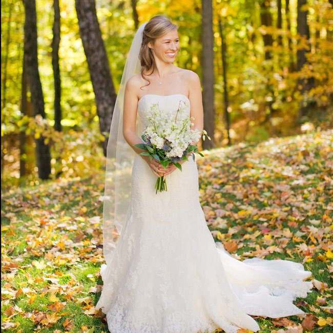 Kayla wore a layered lace fit-and-flare dress with a sash. She completed her look with a long, custom-made veil.