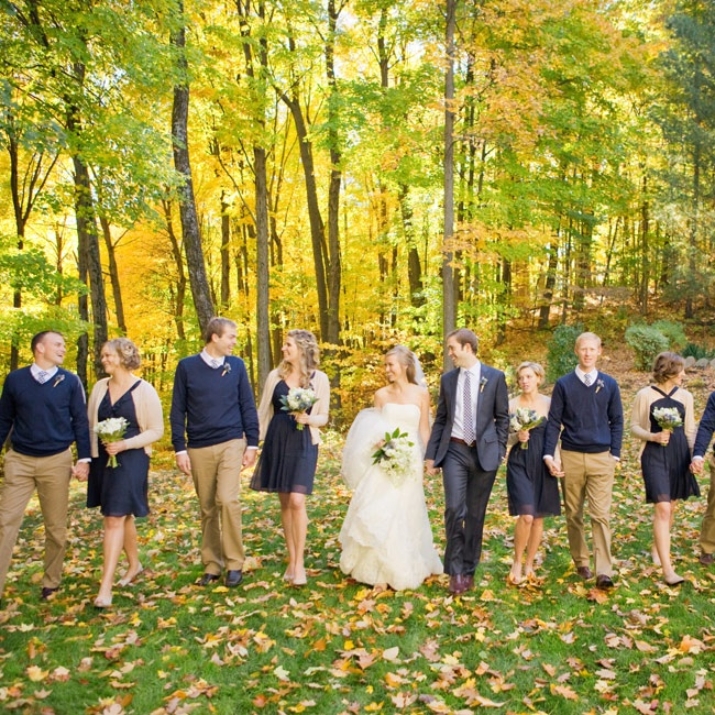 The bridesmaids chose their own knee length dresses in the same navy fabric, while the guys wore navy sweaters and caramel colored khakis.