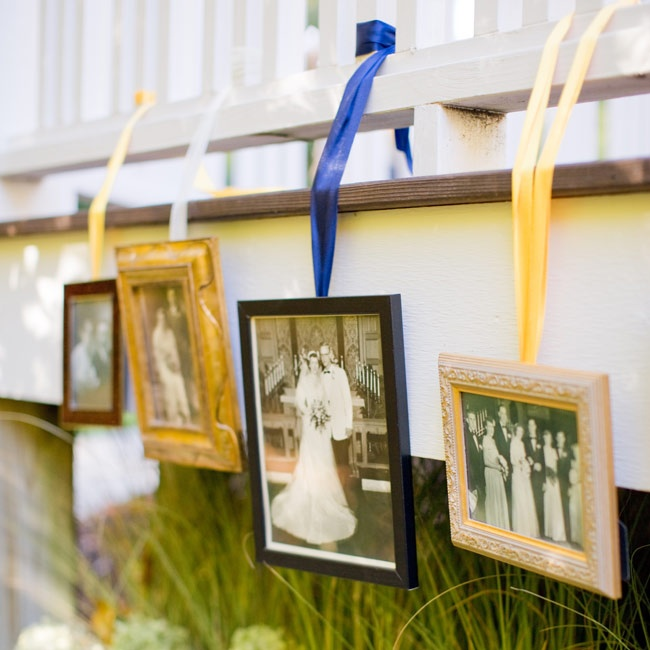 To line the walkway to the ceremony, family wedding photos were hung on ribbon from the deck at Ryan's parents' house.