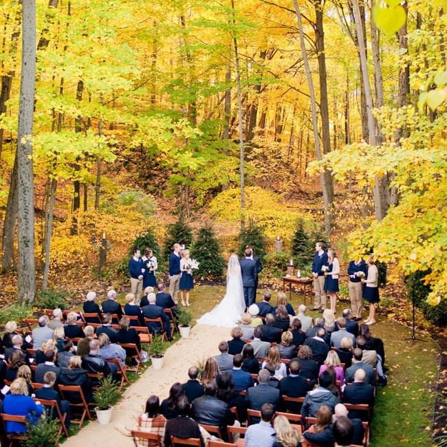 Kayla and Ryan love the outdoors, so it only made sense for them to get married amidst the tall trees in Ryan's parents' backyard.