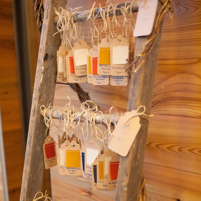 The kraft paper escort cards were tied to rungs of an old ladder that was set up at the reception entrance.