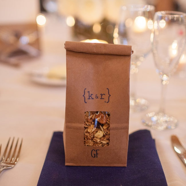 "To go along with the ""rustic elegance"" theme, favors of homemade granola were packaged in brown bags stamped with the couple's logo."