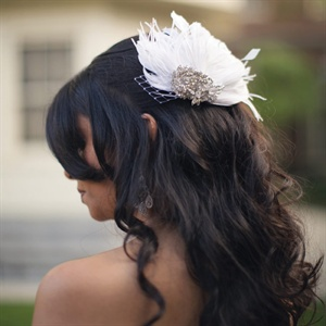 Curled Bridal Hairstyle with White Feather Accessory