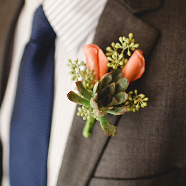The men had coral roses with seeded eucalyptus, and the groom had a succulent on his.