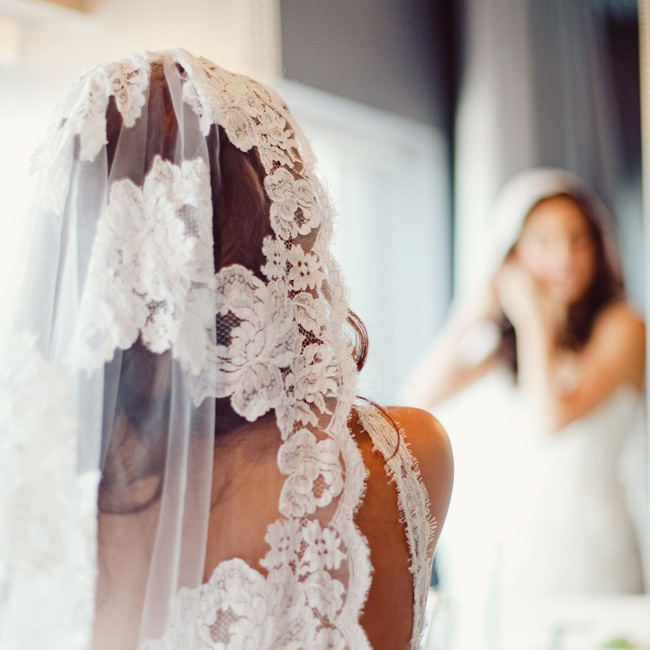 For the traditional Catholic mass, AnaLiza accessorized her dress with the 42-year-old mantilla veil her mother wore on her own wedding day.
