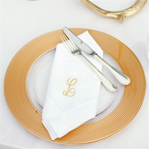 White-and-gold place settings and table décor gave the reception a simple yet elegant feel.
