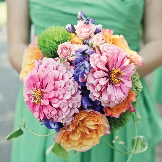 All of the bridesmaids carried bright bunches of roses,