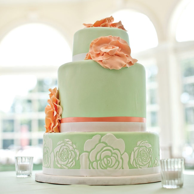 Sage-green fondant and coral-colored sugar