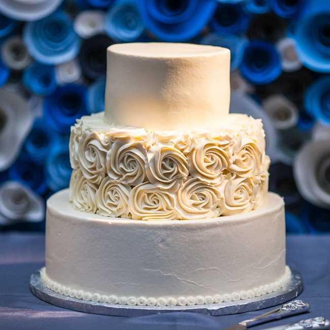 The three-tiered buttercream cake was two different flavors: vanilla with strawberry and cream cheese filling, and chocolate with raspberry and cream cheese filling.