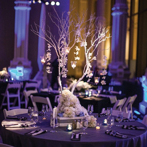 White manzanita branches dripping with votive candles and strings of dendrobium orchids adorned the tables.