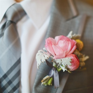Brandon's boutonniere was a variation on Summer's bouquet, made of pink peonies and garden roses, yellow billy balls and greenery.