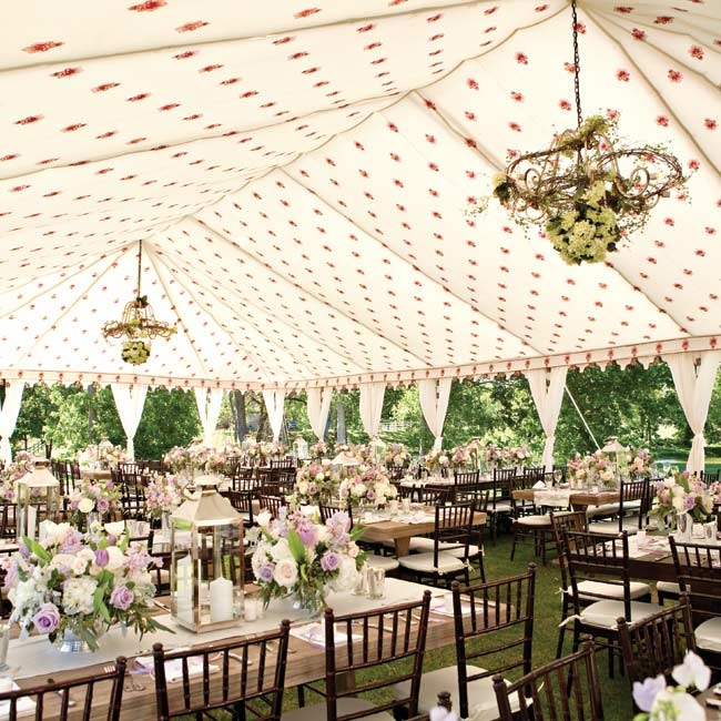 "The tent's decor included multiple floral chandeliers, for a ""French whimsical feel."""